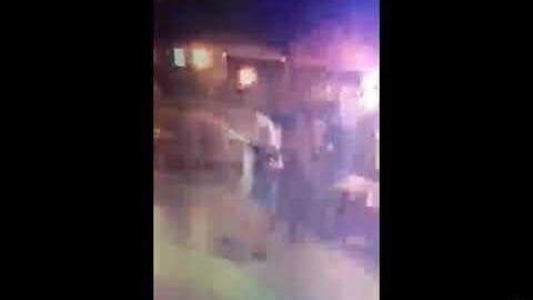 Девушка кокетливо танцует со своим парнем после секса с двумя полицейскими